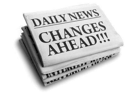 25151434 - daily news newspaper headline reading changes ahead