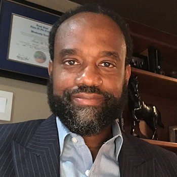 man with beard in a business suit