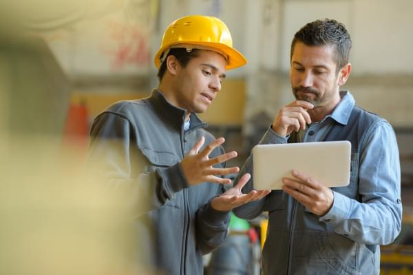 Workers looking at a tablet